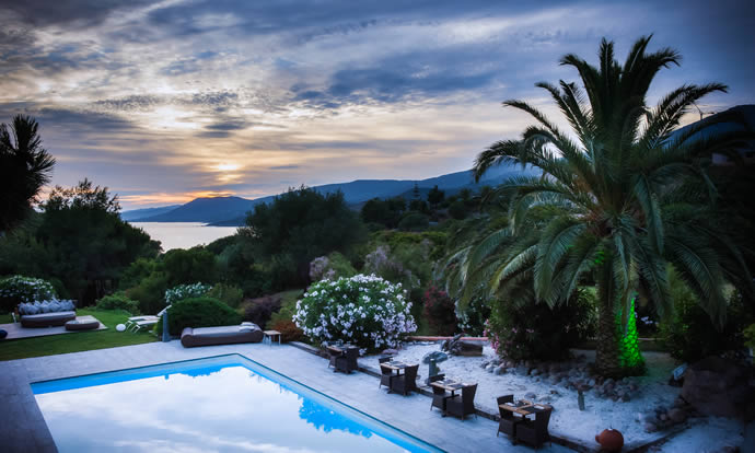 The view across the pool from a stylish Corsican hotel